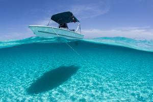 A Boat Is Anchored in the Clear Blue Tropical Waters Off Staniel Cay, Exuma, Bahamas by James White
