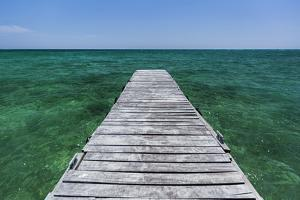 A Wood Dock in the Foreground with Clear Green Water and Blue Skies Near the Isle of Youth, Cuba by James White