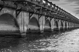 Black and White Horizontal Image of an Old Arch Bridge in Near Ramrod Key, Florida by James White