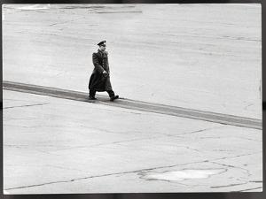 Cosmonaut Yuri Gagarin at Airport, Where Soviet Dignitaries Wait to Honor Him by James Whitmore