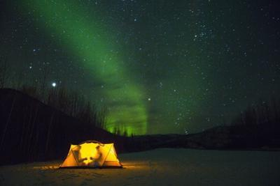 Two Campers Drinking a Bottle of Wine in a Tent under the Northern Lights