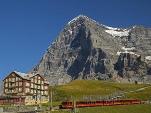 Switzerland, Bern Canton, Kleine Scheidegg, Jungfraubahn Train and the Eiger North Face by Jamie And Judy Wild
