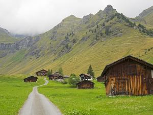 Switzerland, Bern Canton, Murren, Chalets and Barns in Alpine Environment by Jamie And Judy Wild