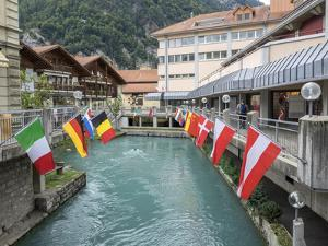 Switzerland, Bern Canton, Unterseen, Flag Display by Jamie And Judy Wild