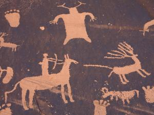 Petroglyphs on Sandstone Rock, Newspaper Rock, near Monticello, Utah, USA by Jamie & Judy Wild