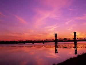 Train Bridge Over Columbia River at Sunrise, Pasco-Kennewick, Washington, USA by Jamie & Judy Wild