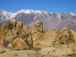 USA, California, Lone Pine. Alabama Hills with the Inyo Mountains. by Jamie & Judy Wild