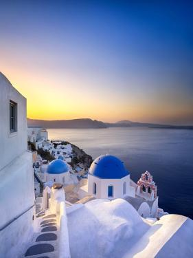 Morning sunlight on the blue houses of Oia, Santorini, Greece by Jan Christopher Becke