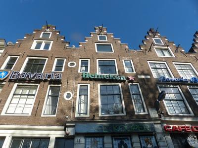 Amsterdam townhouses with beer ads