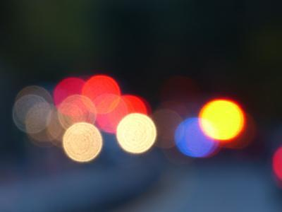 Out of focus images of emergency vehicles, police, fire trucks, etc., attending a car accident