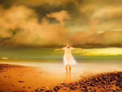 Glowing Woman Standing on the Beach