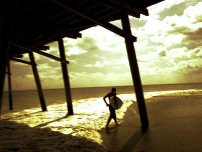 Surfer Walking along Tide