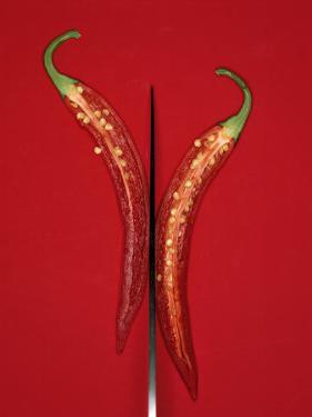 A Red Chili Pepper Sliced in Half by Jan-peter Westermann