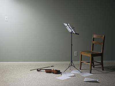 Empty Room with Chair, Violin and Sheet Music on Floor