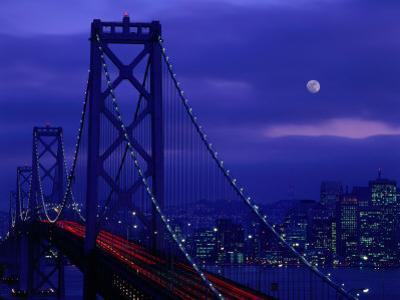 The Bay Bridge with a Full Moon and City Skyline, San Francisco, California, USA