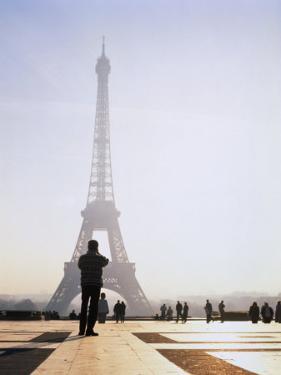 Tourist Taking Photograph of the Eiffel Tower, Paris, Ile-De-France, France by Jan Stromme