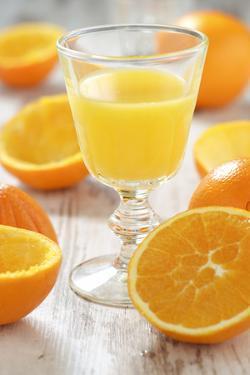 Fresh Pressed Orange Juice and Oranges by Jana Ihle