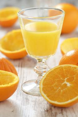 Fresh Pressed Orange Juice and Oranges by Jana Ihle