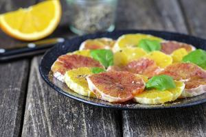 Orange Salad and Blood Orange Salad on Dark Plate by Jana Ihle