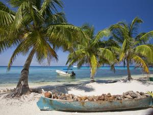 Belize, Laughing Bird Caye, Canoe Filled with Coconut Husks on Beach by Jane Sweeney