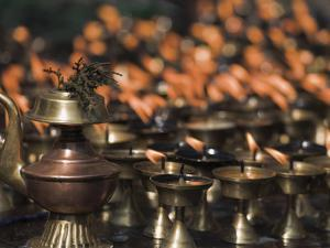 Candles, Lhosar, Bodhnath, Bagmati, Kathmandu, Nepal by Jane Sweeney