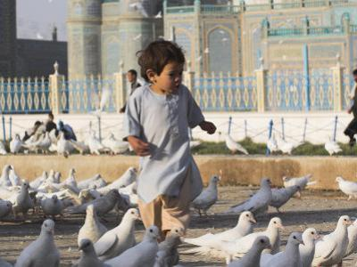Child Chasing the Famous White Pigeons, Mazar-I-Sharif, Afghanistan by Jane Sweeney