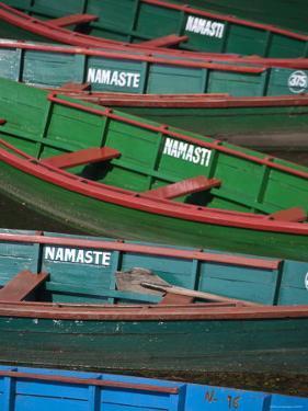 Colourful Canoes on Phewa Lake, Pokhara, Nepal by Jane Sweeney