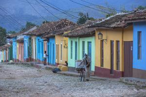 Cuba, Trinidad, a Man Selling Sandwiches Up a Colourful Street in Historical Center by Jane Sweeney