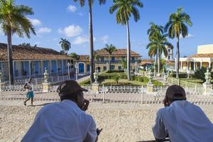 Cuba, Trinidad, Two Security Guards Look across Plaza Mayor by Jane Sweeney