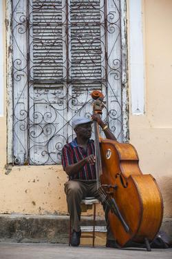 Santiago De Cuba Province, Historical Center, Street Musician Playing Double Bass by Jane Sweeney