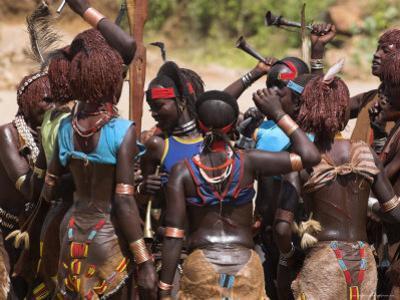 Women Sing and Dance Before the Bull Jumping, Turmi, Ethiopia