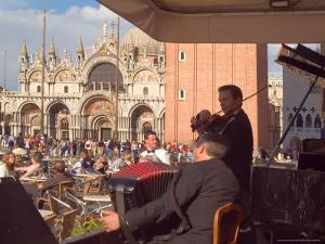 Band Playing for the Crowd in the Piazza San Marco, Venice, Italy by Janis Miglavs