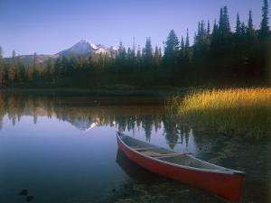 Beached Red Canoe, Sparks Lake, Central Oregon Cascades by Janis Miglavs