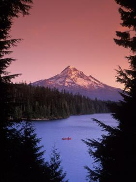 Canoeing on Lost Lake in the Mt Hood National Forest, Oregon, USA by Janis Miglavs