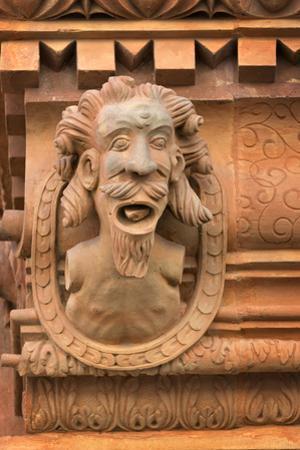 France, Alsace, Colmar. Gargoyle head on the facade of Maison des Tetes. by Janis Miglavs