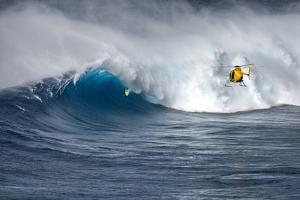 Hawaii Maui. Helicopter Crew Filming Kyle Lenny Surfing Monster Waves at Pe'Ahi Jaws by Janis Miglavs
