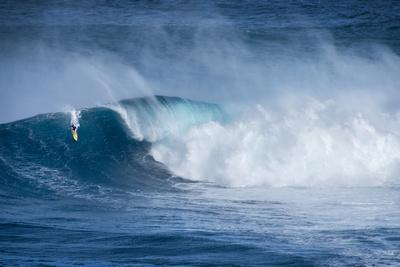 Hawaii, Maui. Kai Lenny Surfing Monster Waves at Pe'Ahi Jaws, North Shore Maui