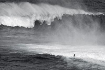 Hawaii, Maui. Lone Figure Surfing Monster Waves at Pe'Ahi Jaws, North Shore Maui by Janis Miglavs