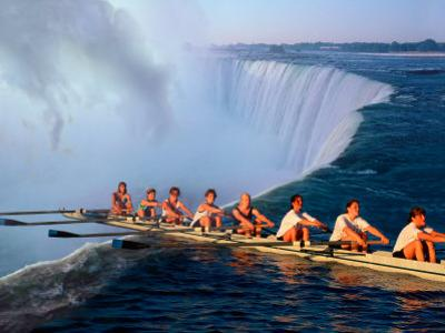 Rowers Hang Over the Edge at Niagra Falls, US-Canada Border by Janis Miglavs