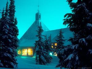 Timberline Lodge at Night in the Snow, Oregon Cascades, USA by Janis Miglavs