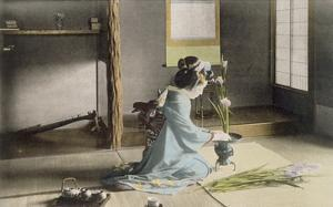 Girl Arranging Flowers (Hand Coloured Photo) by Japanese Photographer