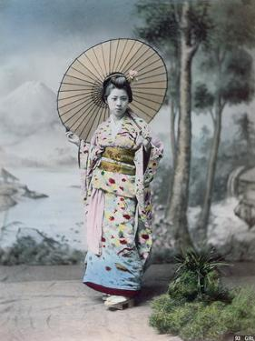 Young Japanese Girl in a Kimono and with a Parasol, Mt.Fuji in the Background, c.1900 by Japanese Photographer