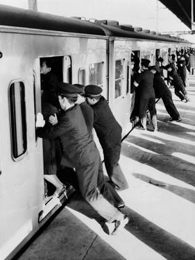 Japanese Students Employed as Uniformed 'Pushers' Cramming Commuter Cars, 1962