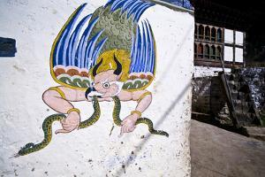 A Colorful Mural of Garuda Eating a Snake on the Wall of a Home Near a Buddhist Monastery by Jason Edwards
