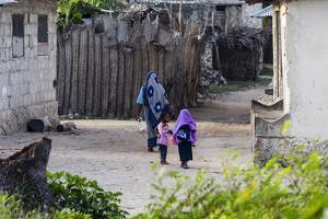 A Muslim Mother and Her Daughters Walking Through Lanes in an Island Village by Jason Edwards