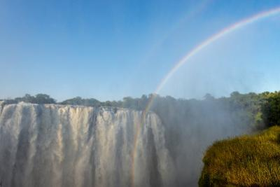 A Rainbow Rises from the Depths of First Gorge Through the Victoria Falls Mist by Jason Edwards