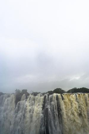 A Rainstorm Falls over the Cascading Victoria Falls Already in Flood by Jason Edwards