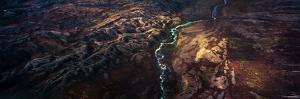 A Sunray Touches a Winding River Snakes its Way Through a Highland Tundra Valley by Jason Edwards