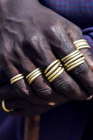 A Teenage Maasai Warrior, a Moran, with His Fingers Adorned in Gold Rings by Jason Edwards
