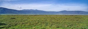 A Vast Short Grass Savannah Plain Surrounded by a Volcano Caldera Wall by Jason Edwards